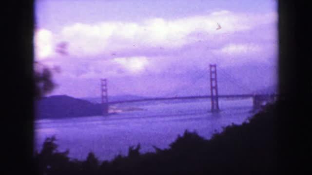1939: Golden gate bridge presidio community buildings car driving pov.