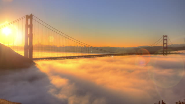 golden gate bridge spectacular sunrise with low fog. - california video stock e b–roll