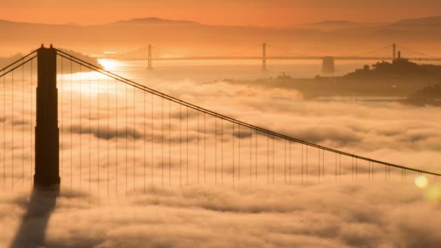 Golden Gate Bridge Sunrise in Low Fog with Warm Morning Light