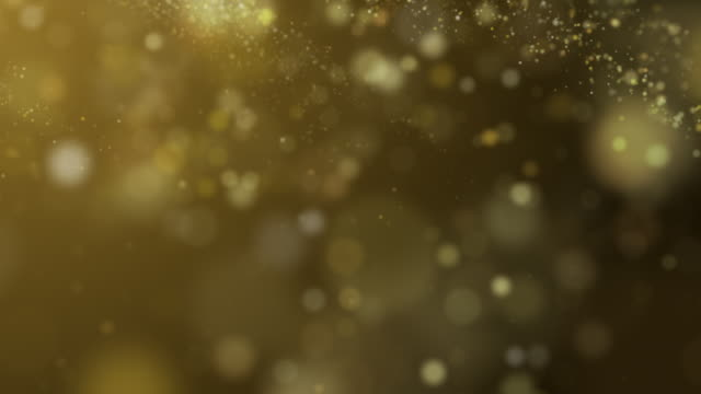 Golden glitter particle flying on the air by wind