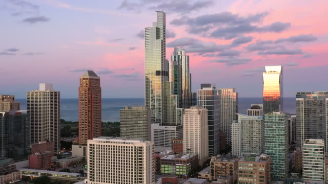 Golden Hour in the South Loop - Chicago - Aerial View Aerial View of Chicago at Dusk - 2019 chicago architecture stock videos & royalty-free footage