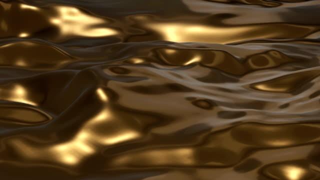 altın sıvı yüzey - gold texture stok videoları ve detay görüntü çekimi