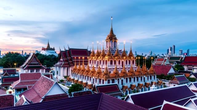 Golden metal castle illuminated, Wat Ratchanatdaram Woravihara, Loha Prasat temple in the morning at Bangkok