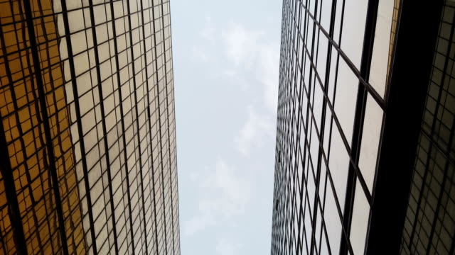 golden modern business buildings, low angle view - abstract architecture стоковые видео и кадры b-roll