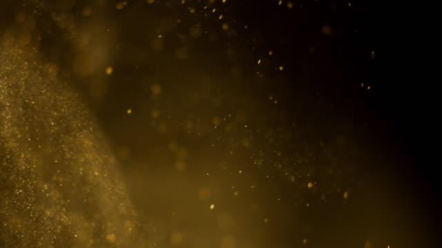 黄金の粒子の背景。本当の - 素材点の映像素材/bロール