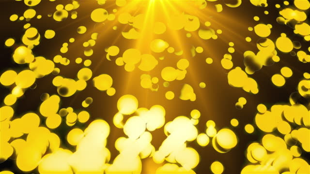 Golden rain of round particles with rays of light, 3D rendering. Computer generated beautiful background