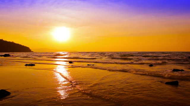 Golden sea wave and sun with reflection video