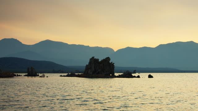 Golden Sky Behind Tufa Formations at Mono Lake, California at Sunset video