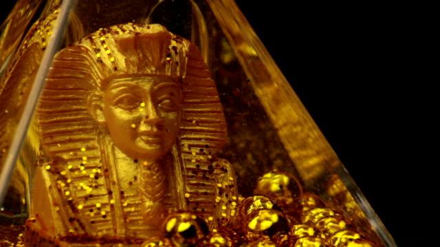 golden statue of an Egyptian pharaoh video