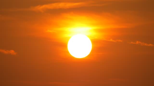 Golden sun on a red sky