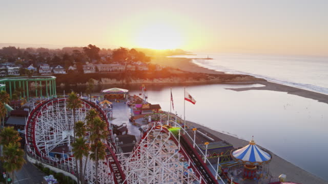 golden sunrise over santa cruz beach and boardwalk - aerial shot - luna park video stock e b–roll