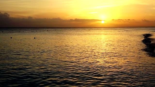 Golden sunrise sunset over the sea ocean video