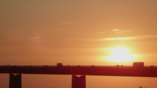 Golden Sunset Along the Great Belt Bridge in Denmark
