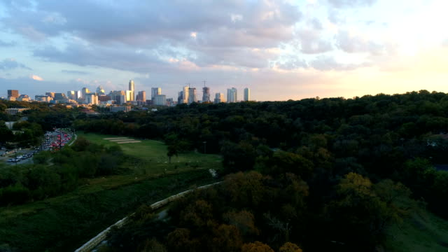 Golden sunset nature meets the city as colorful sunset paints the city colors Austin , Texas video