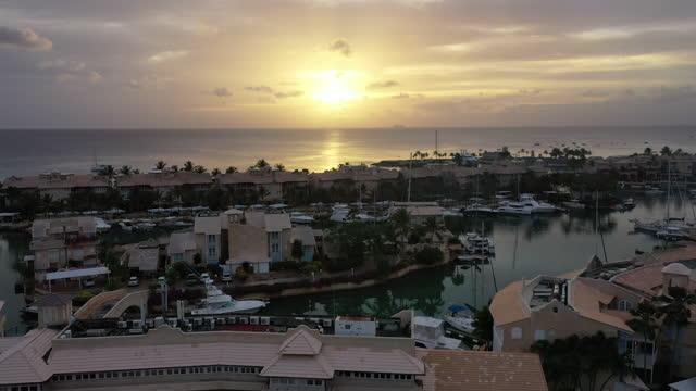 Golden sunset over tropical lagoon community video