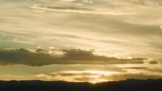 A Golden Utah Sunset with Clouds over a Mountain Range