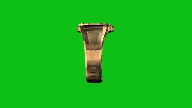 Boucle d'or montre tournent sur fond de chromakey vert - Vidéo