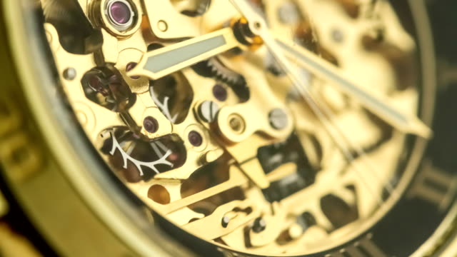 Golden Watch Mechanism Working Golden wrist watch mechanism working in a time lapse video clip in 4k res taken with a macro lens instrument of time stock videos & royalty-free footage