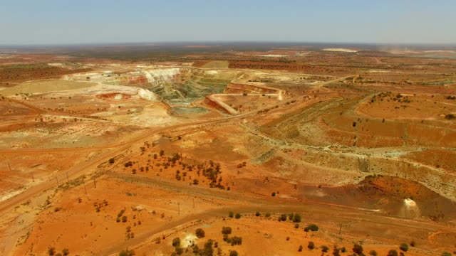 goldfields and gold mine in the australian outback. aerial view - дикая местность стоковые видео и кадры b-roll