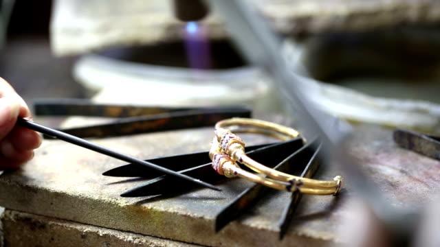 Goldsmith Jeweler use gasoline burner melting and decorating bracelet video