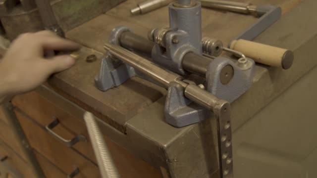 goldsmith measures a golden ring on a sizer gauge and uses size machine video