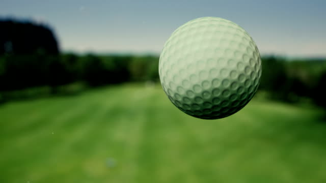 golf ball in the air - super slow motion - taking a shot sport stock videos & royalty-free footage