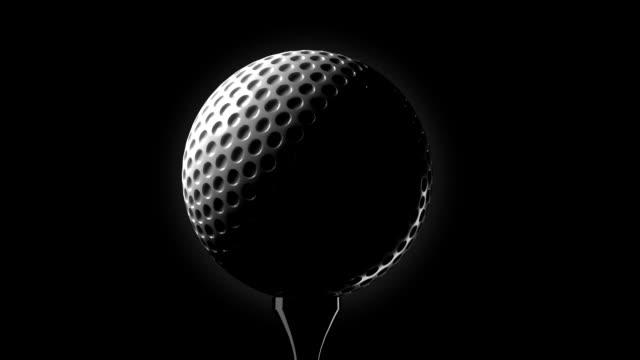 Golf ball on tee closeup video