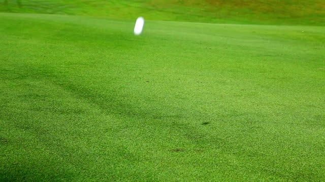 Golf Ball Rolling on the Green Grass video