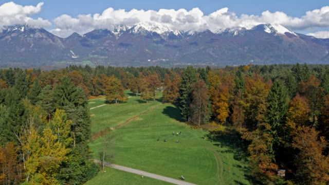 AERIAL Golf course with mountains in the background video