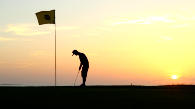 golf player make tee off on a golf course golf player make tee off on a golf course military private stock videos & royalty-free footage