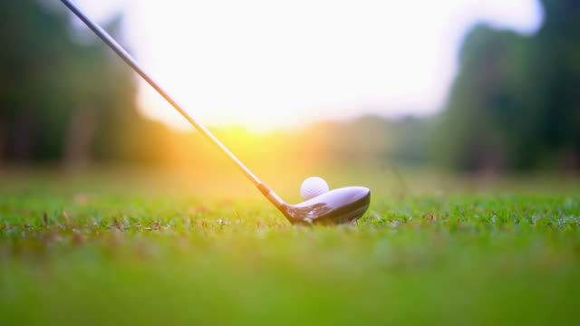 Golf slow motion golfer hitting golf ball in tee off area on morning in beautiful golf course. Fairway and layout beauty and player exercise to good health video