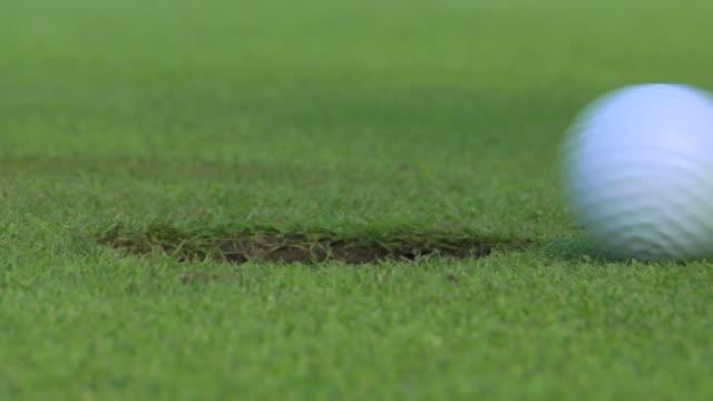 golf: rallentatore - foro video stock e b–roll