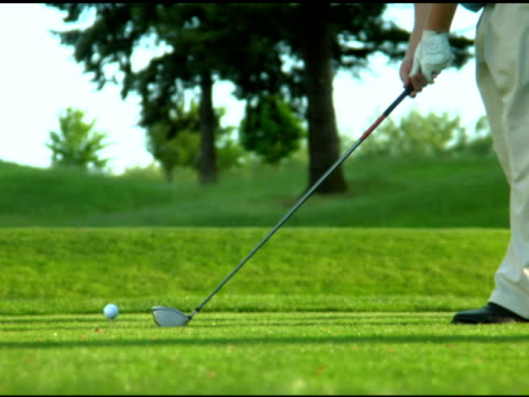 NTSC- Golf swing and hit wide shot video