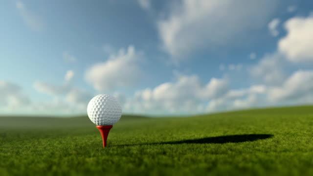 Golfball on tee against beautiful timelapse blue sky