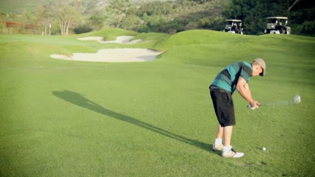 Golfer hit good chip shot onto green, filmed in HD. video