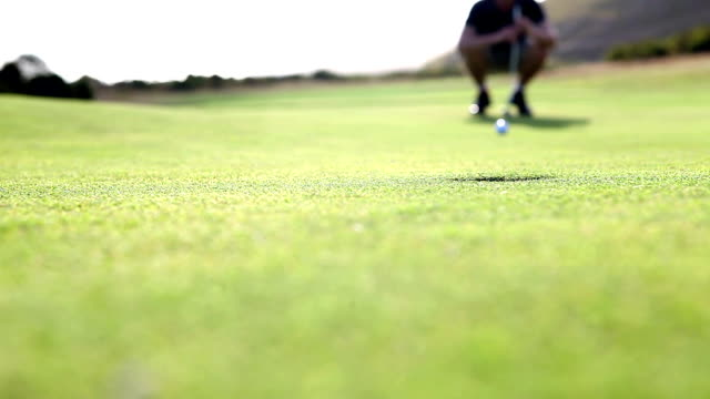 Golfer sinks the putt video