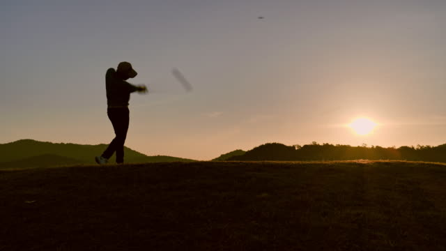 Golfers hit sweeping in the summer for relax time, sport concept.