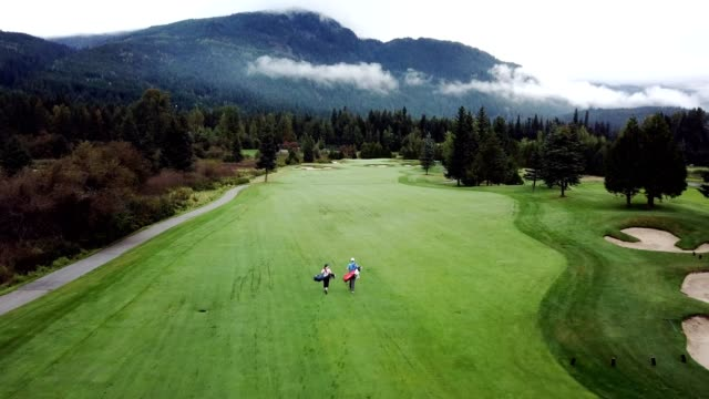 Golfers walking the course