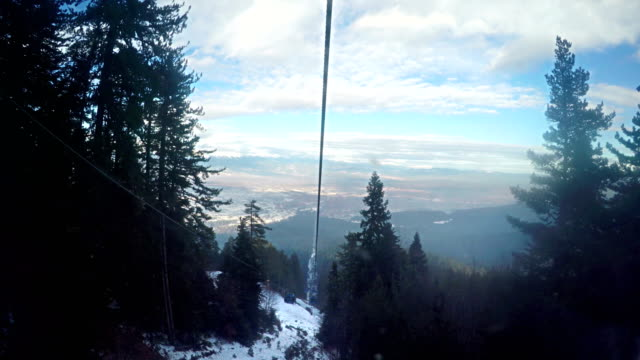 gondola cable car pov timelapse ride at ski resort, 4k - tranvia video stock e b–roll