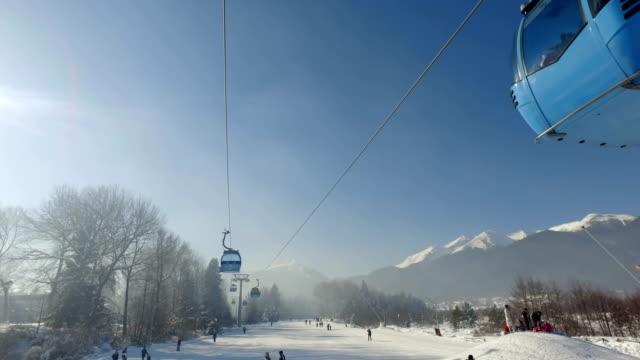 Gondola ski lift transport people to ski slopes video