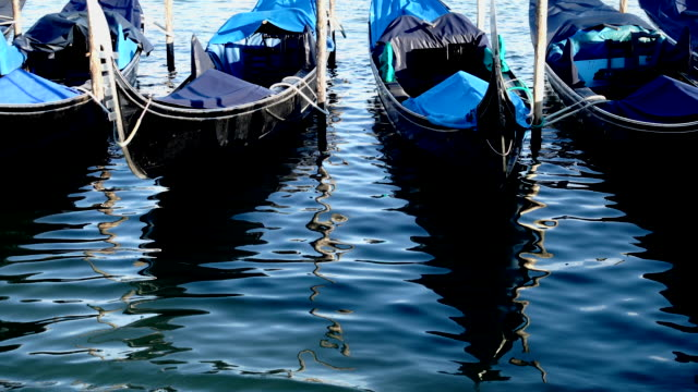 gondolas on the venetian lagoon - italian architecture stock videos & royalty-free footage