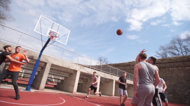 Good basketball assistance finished with points Group of young adults playing amateur basketball outdoor practice drill stock videos & royalty-free footage