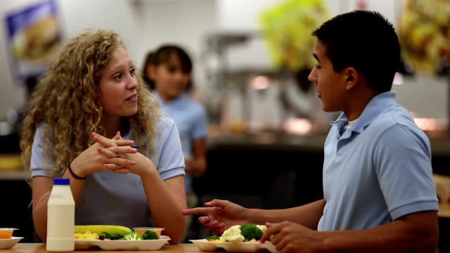 Good friends talking in school cafeteria Good friends talking in school cafeteria. cafeteria stock videos & royalty-free footage