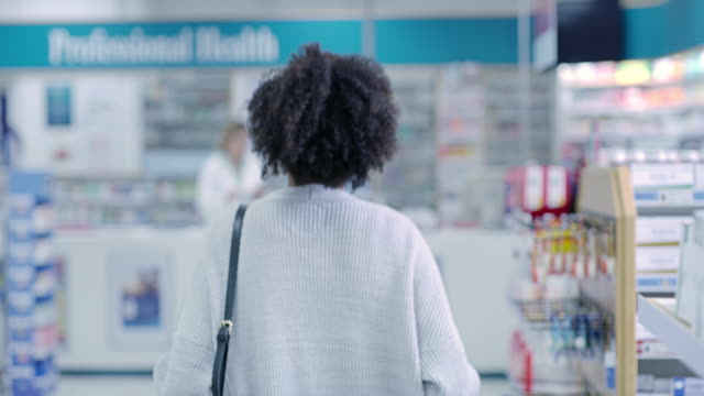 Good health starts now 4k video footage of a young pharmacist helping a customer in a pharmacy pharmaceutical industry stock videos & royalty-free footage