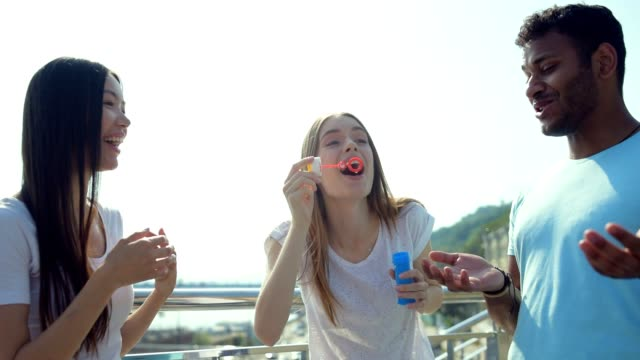 Good looking girl blowing bubbles video
