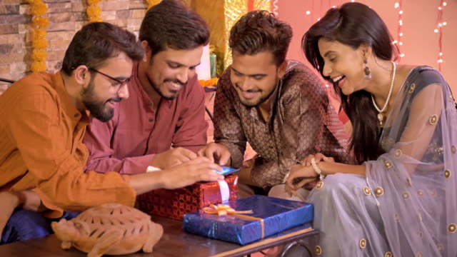 Good looking office colleagues using an application or shopping online on a cell phone during Diwali video