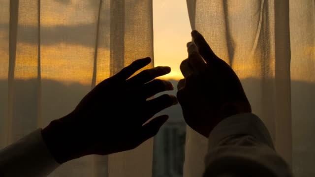 Good morning,Man hand open curtain
