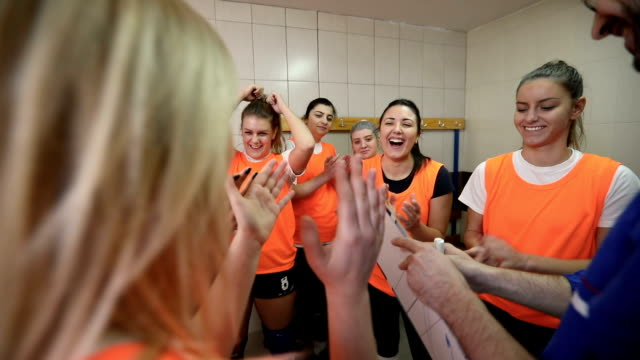 Good team spirit Good team spirit before the volleyball match in locker room. volleyball sport stock videos & royalty-free footage