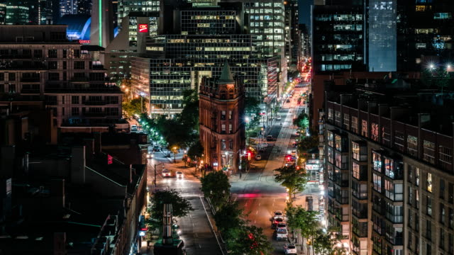 gooderham building city traffic in toronto - canada travel stock videos and b-roll footage