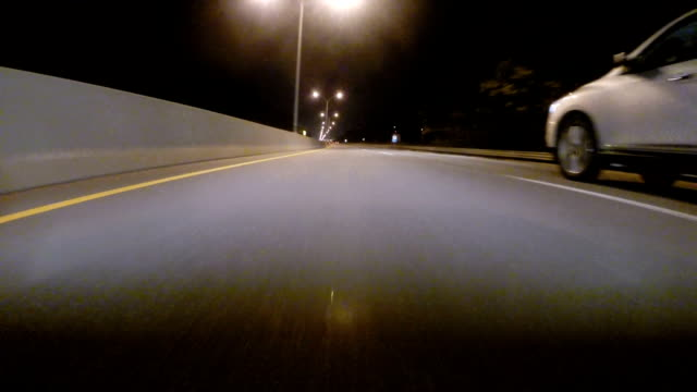 GoPro attached to bumper of car at night driving through neighborhood and on highway 10x speed video